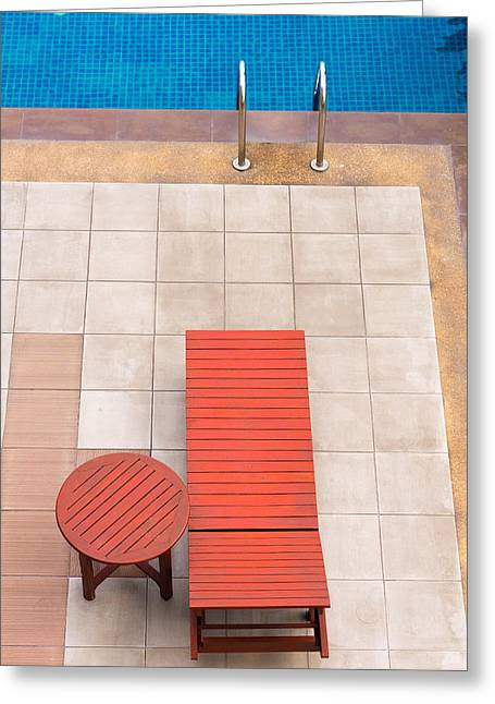 Swim Ladder Greeting Cards - Poolside Deckchairs Alongside Blue Swimming Pool From Top View Greeting Card by Jirawat Cheepsumol
