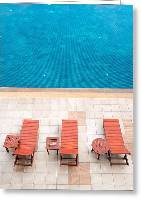 Swim Ladder Greeting Cards - Poolside Deckchairs Alongside Blue Swimming Pool Greeting Card by Jirawat Cheepsumol