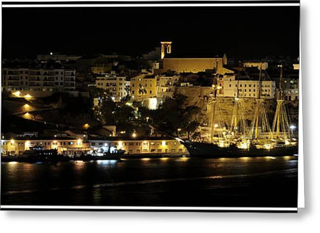 Docked Sailboat Greeting Cards - Juan Sebastian de Elcano famous tall ship of Spanish navy visits Port Mahon at night panorama Greeting Card by Pedro Cardona