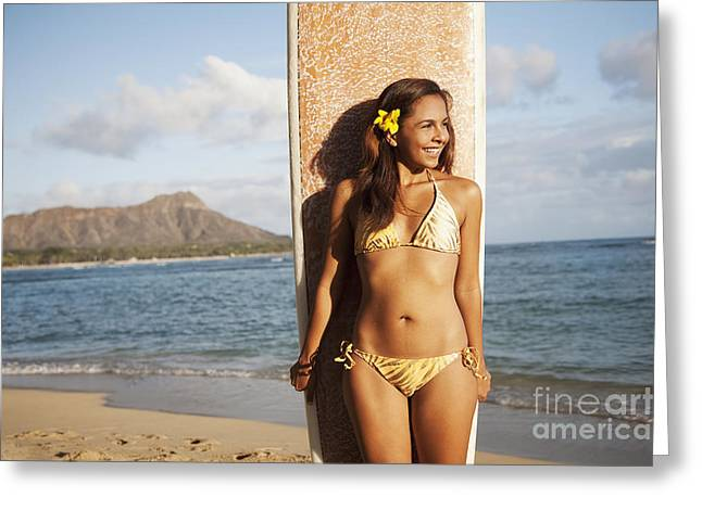 Images Of Woman Greeting Cards - Portrait of a woman on a beach in a bikini holding a surfboard_ Waikiki, Oahu, Hawaii, United States of America Greeting Card by Brandon Tabiolo