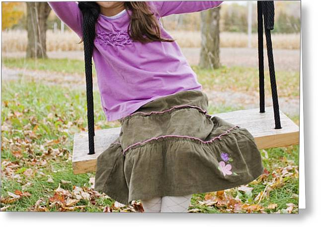 Portrait Of Young Girl On Swing Greeting Card by Vast Photography