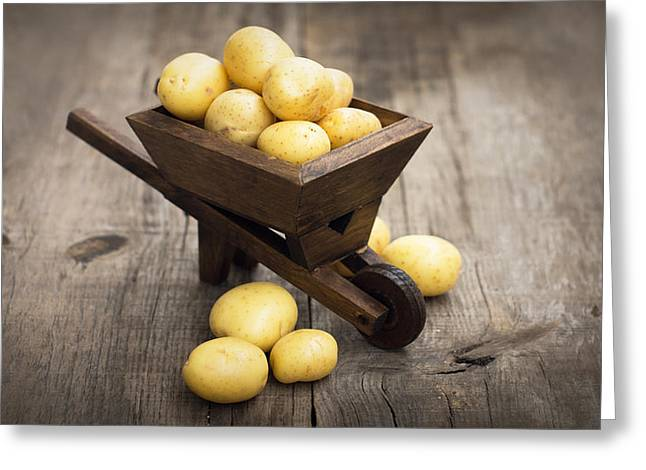 Produce Greeting Cards - Potatos in a miniature wheelbarrow Greeting Card by Aged Pixel