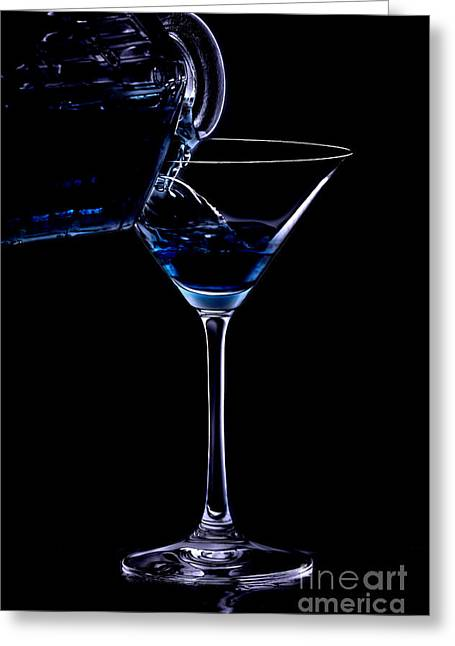 Isolated Against Black Background Greeting Cards - Pouring a drink in the night Greeting Card by Martina Roth