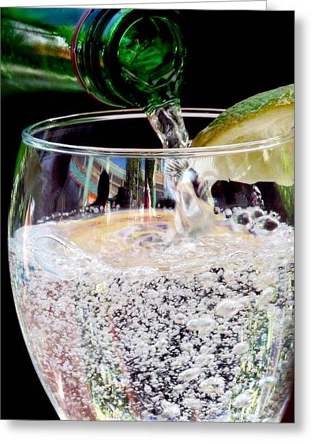 Water Into Wine Greeting Cards - Pouring Bubbles Into Glass Greeting Card by Jeff Lowe