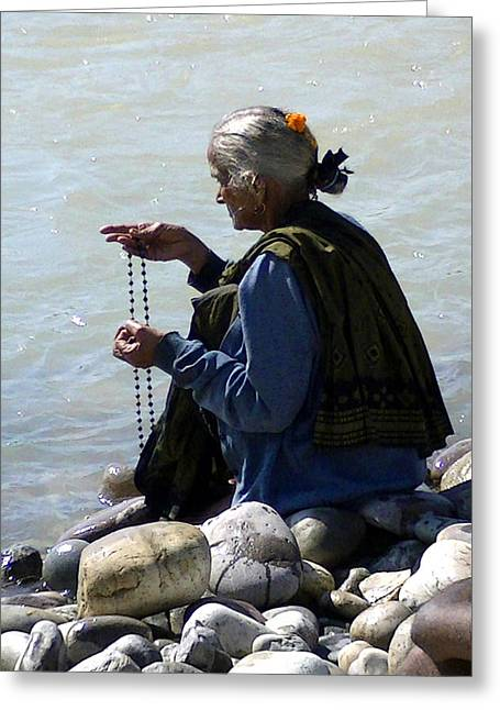 Prayer Beads Greeting Cards - Prayer by the Ganges Greeting Card by Catherine Arnas