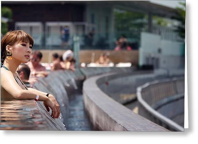Pretty Japanese Tourist Staying At Marina Bay Sands Soaking In The Infinity Pool And Enjoying Singap Greeting Card by Chris Quek