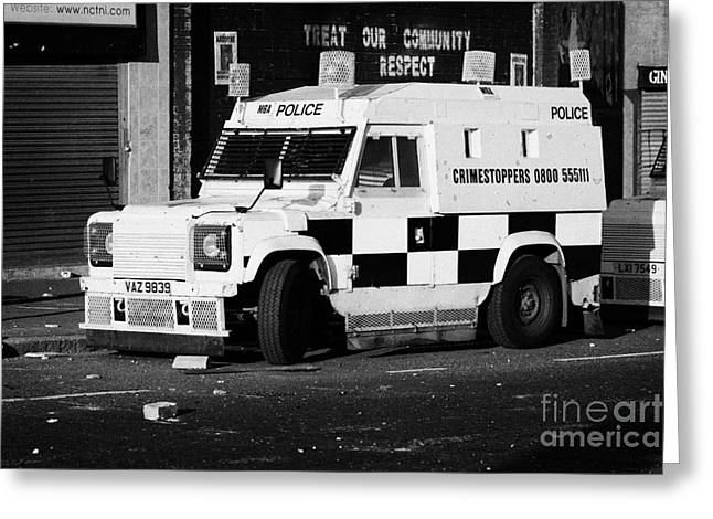 Terrorism Greeting Cards - PSNI armoured land rover on crumlin road at ardoyne shops belfast 12th July Greeting Card by Joe Fox