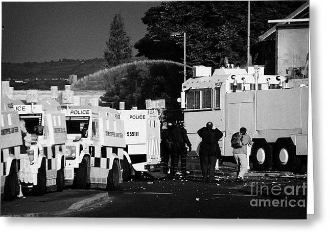 Terrorism Greeting Cards - PSNI armoured land rovers and water canon on crumlin road at ardoyne shops belfast 12th July Greeting Card by Joe Fox