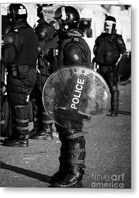 Terrorist Greeting Cards - PSNI officer in full riot gear with shield on crumlin road at ardoyne shops belfast 12th July Greeting Card by Joe Fox