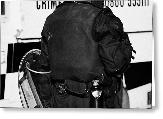 PSNI officer with riot gear on crumlin road at ardoyne shops belfast 12th July Greeting Card by Joe Fox