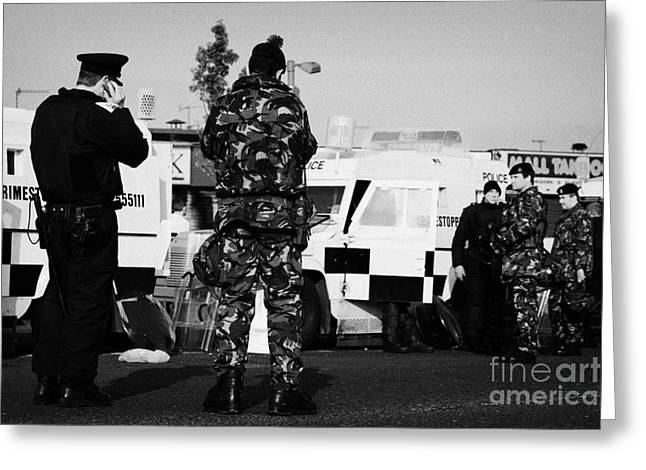 Terrorism Greeting Cards - PSNI officers and British Army soldiers at PSNI landrovers on crumlin road at ardoyne shops belfast  Greeting Card by Joe Fox