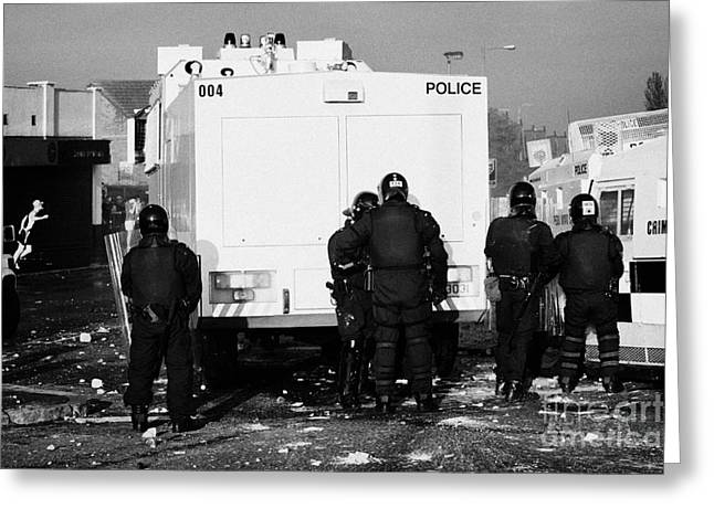 Terrorism Greeting Cards - PSNI officers behind water canon during riot on crumlin road at ardoyne shops belfast 12th July Greeting Card by Joe Fox