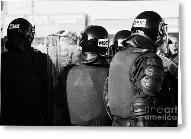 Terrorism Greeting Cards - PSNI officers in riot gear with crowd on crumlin road at ardoyne shops belfast 12th July Greeting Card by Joe Fox