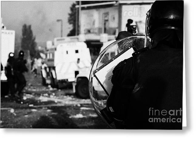 Terrorist Greeting Cards - PSNI riot officer with baton round warning on shield watches rioting on crumlin road at ardoyne shop Greeting Card by Joe Fox