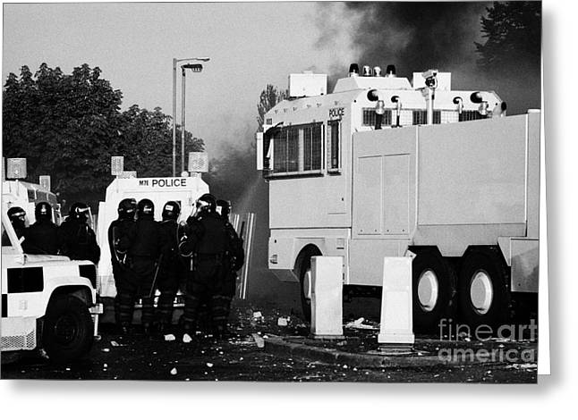 Protest Greeting Cards - PSNI riot officers behind armoured land rover and water cannon on crumlin road at ardoyne shops belf Greeting Card by Joe Fox