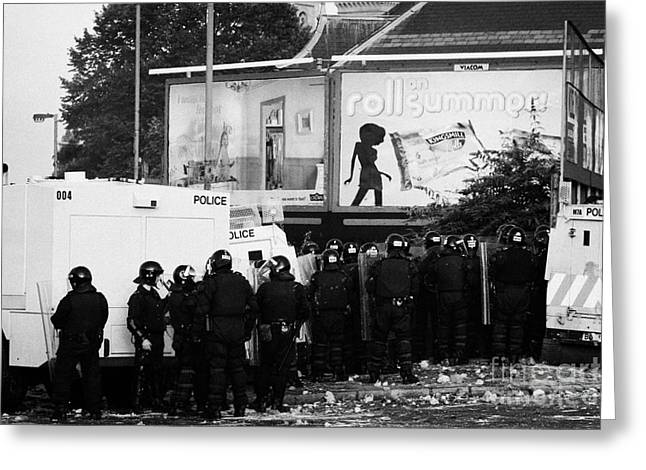 Terrorist Greeting Cards - PSNI riot officers behind armoured land rover water cannon beneath on crumlin road at ardoyne shops  Greeting Card by Joe Fox