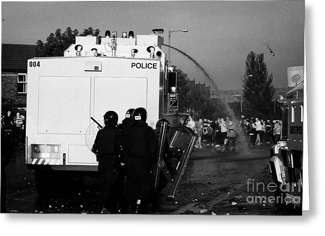 Terrorist Greeting Cards - PSNI riot officers behind water canon during rioting on crumlin road at ardoyne Greeting Card by Joe Fox