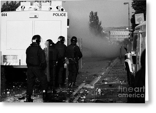 Terrorist Greeting Cards - PSNI riot officers behind water canon during rioting on crumlin road at ardoyne shops belfast 12th J Greeting Card by Joe Fox