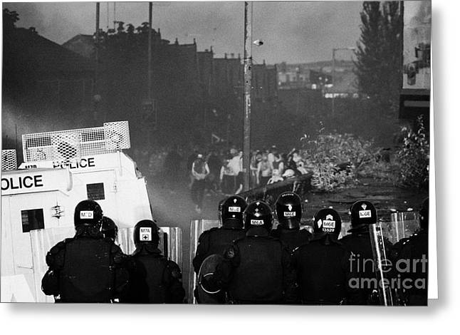 Psni Riot Officers Face Rioters Mob On Crumlin Road At Ardoyne Shops Belfast 12th July Greeting Card by Joe Fox