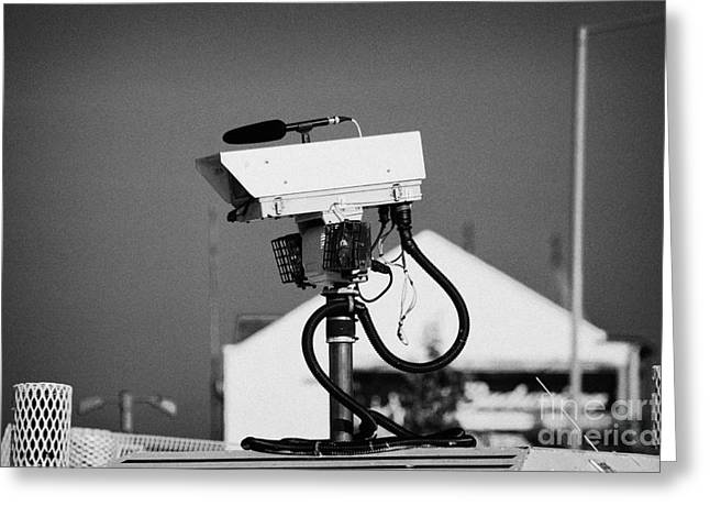 Terrorism Greeting Cards - PSNI surveillance land rover spy camera on crumlin road at ardoyne shops belfast 12th July Greeting Card by Joe Fox