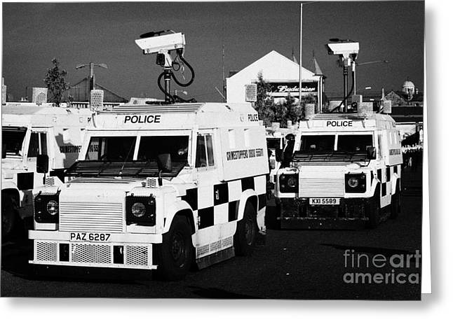 Terrorism Greeting Cards - PSNI surveillance landrovers with cameras on crumlin road at ardoyne shops belfast 12th July Greeting Card by Joe Fox