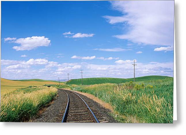 Open Land Greeting Cards - Railroad Track Passing Through A Field Greeting Card by Panoramic Images