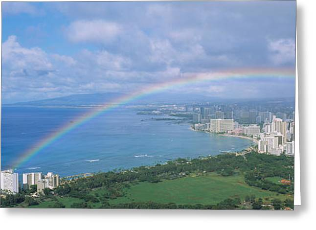 Panoramic Ocean Greeting Cards - Rainbow Over A City, Waikiki, Honolulu Greeting Card by Panoramic Images