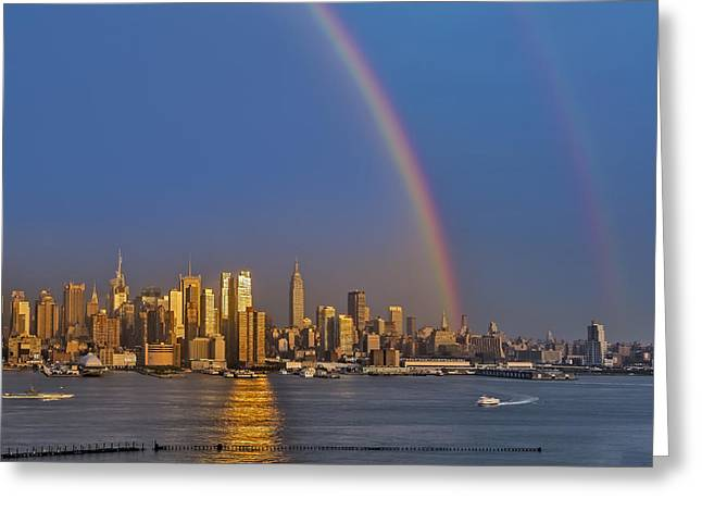 Rainbows Over The New York City Skyline Greeting Card by Susan Candelario