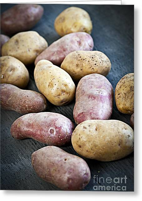 Organic Photographs Greeting Cards - Raw potatoes Greeting Card by Elena Elisseeva