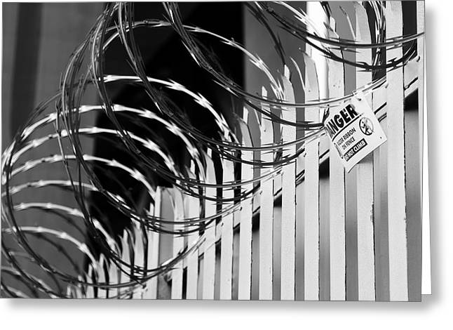 Border Photographs Greeting Cards - Razor wire Greeting Card by Les Cunliffe