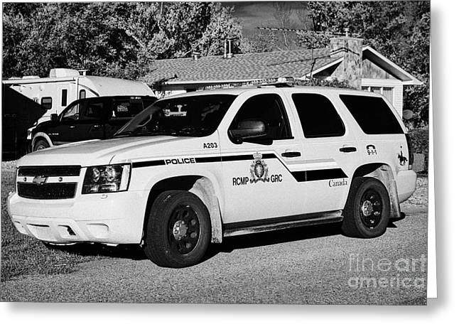 Squad Car Greeting Cards - rcmp police patrol car parked outside a small town house in rural Saskatchewan Canada Greeting Card by Joe Fox