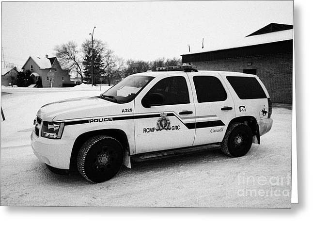 Squad Car Greeting Cards - rcmp royal canadian mounted police 4x4 patrol vehicle outside station in the small town of Kamsack S Greeting Card by Joe Fox