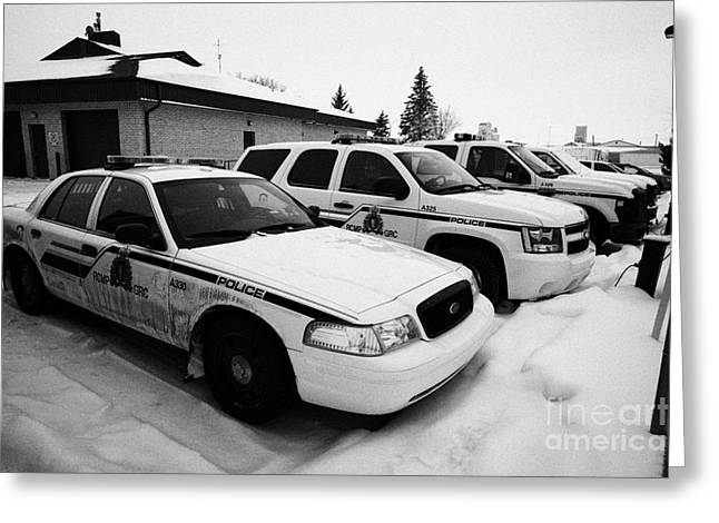 Squad Car Greeting Cards - rcmp royal canadian mounted police vehicles outside station in the small town of Kamsack Saskatchewa Greeting Card by Joe Fox
