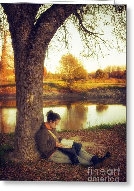 Reading Under The Tree Greeting Card by Carlos Caetano