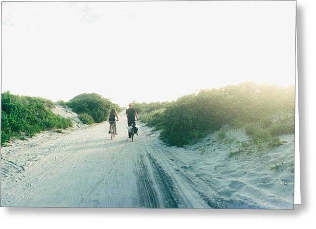 Two Bikes Greeting Cards - Rear View Of A Couple Cycling Greeting Card by Panoramic Images