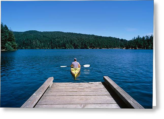 Waist Up Greeting Cards - Rear View Of A Man On A Kayak Greeting Card by Panoramic Images