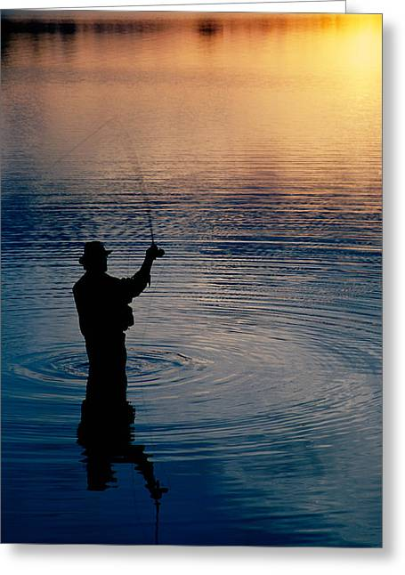 Transitions Greeting Cards - Rear View Of Fly-fisherman Silhouetted Greeting Card by Panoramic Images