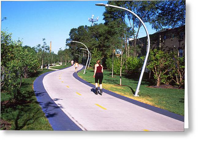 Rear View Of Woman Jogging In A Park Greeting Card by Panoramic Images