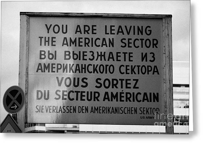 Berlin Germany Greeting Cards - reconstruction of the you are leaving the american sector sign at checkpoint charlie Berlin Germany Greeting Card by Joe Fox