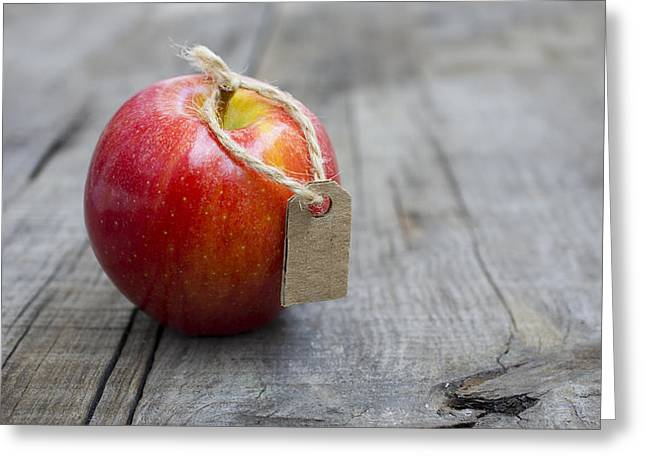 Label Photographs Greeting Cards - Red Apple with a Price Label Greeting Card by Aged Pixel