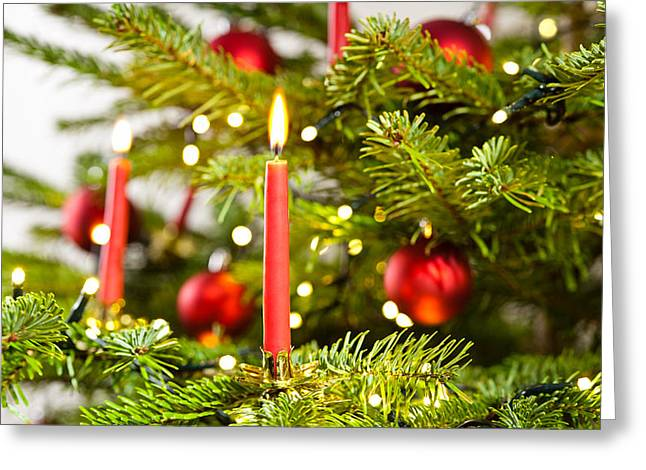 Candle Lit Greeting Cards - Red Candle In Christmas Tree Greeting Card by Ulrich Schade