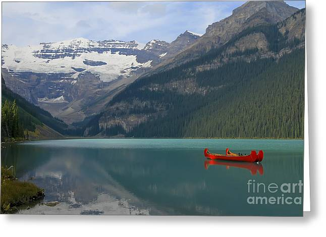 Canoe Greeting Cards - Red Canoes on Lake Louise Greeting Card by Teresa Zieba