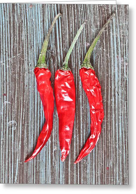 Red Chilis Greeting Card by Tom Gowanlock