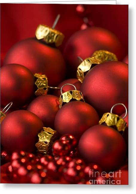 Trimmings Greeting Cards - Red Christmas Baubles Greeting Card by Anne Gilbert