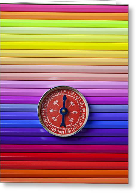 Longitude Greeting Cards - Red compass on rolls of colored pencils Greeting Card by Garry Gay