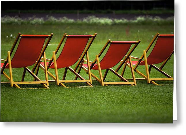 Daybed Greeting Cards - Red deck chairs on the green lawn Greeting Card by Mikhail Pankov