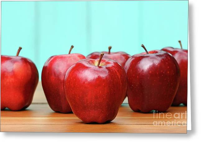 Red Delicious Apples On Old School Desk Greeting Card by Sandra Cunningham