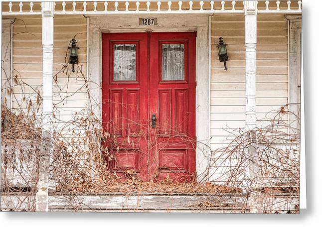 Old Houses Greeting Cards - Red doors - Charming old doors on the abandoned house Greeting Card by Gary Heller