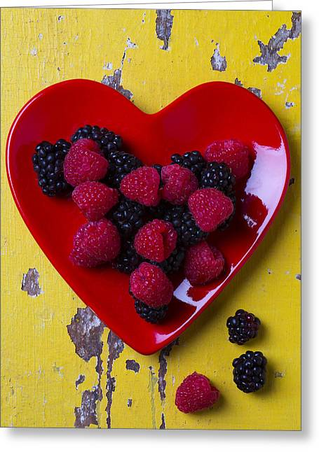 Edible Greeting Cards - Red heart dish and raspberries Greeting Card by Garry Gay