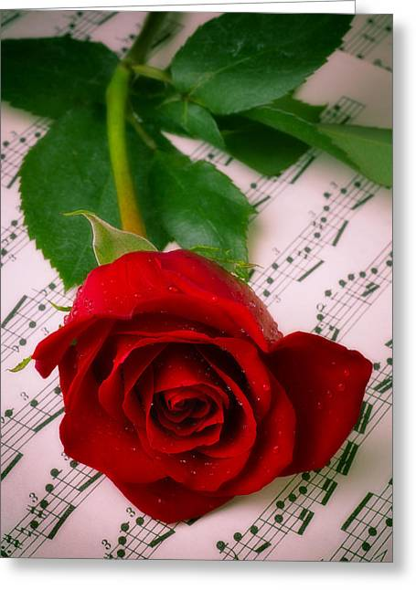 Composing Greeting Cards - Red Rose On Sheet Music Greeting Card by Garry Gay